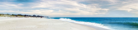 Morning tide coming ashore at Fire Island. Digiral color panorama.