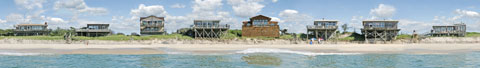 Panorama of buildings viewed from the ocean side of Fire Island. Large size gallery print.