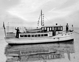Steam boat in Fire Island Marina, black and white photograph, digitally restored and printed