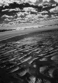 Black and white fine art print of the ocean after a tide. Infrared photography with digital Canon camera