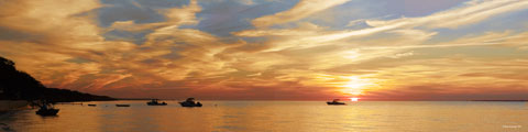 Boats on the ocean at sunset. Large size panoramic photograph.
